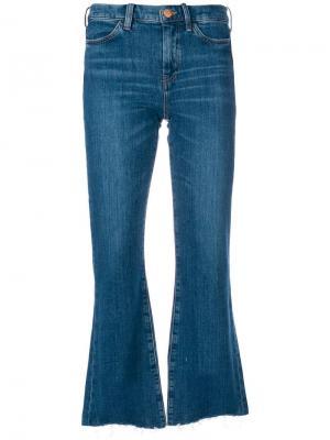 Расклешенные джинсы с необработанным низом Mih Jeans. Цвет: синий