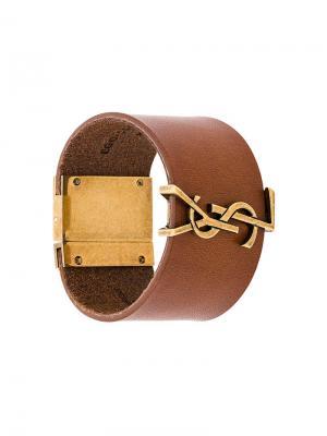 Браслет-кафф с монограммой Saint Laurent. Цвет: коричневый