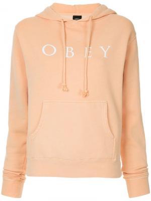 Толстовка с капюшоном и принтом логотипа Obey. Цвет: розовый