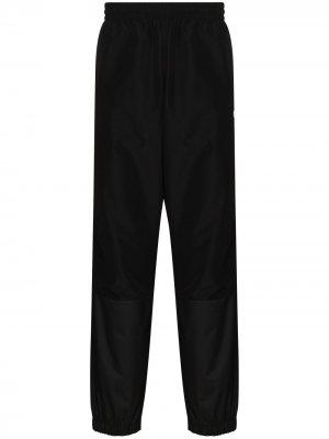 Зауженные спортивные брюки со вставками Champion. Цвет: черный