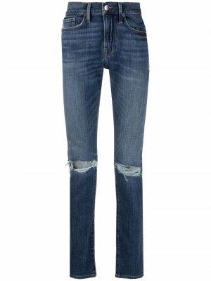 Узкие джинсы с прорезями FRAME. Цвет: синий