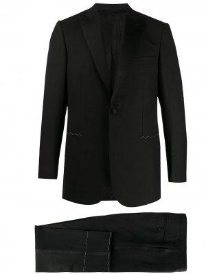 Строгий костюм-двойка Brioni. Цвет: черный