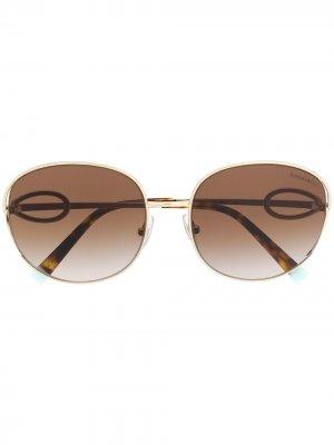 Солнцезащитные очки в массивной оправе Tiffany & Co Eyewear. Цвет: золотистый