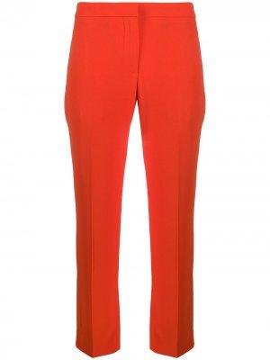 Строгие брюки кроя слим Alexander McQueen. Цвет: оранжевый