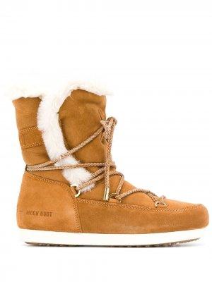 Зимние ботинки с оторочкой из овчины Moon Boot. Цвет: коричневый