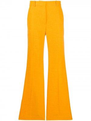 Расклешенные брюки Tena Joseph. Цвет: оранжевый