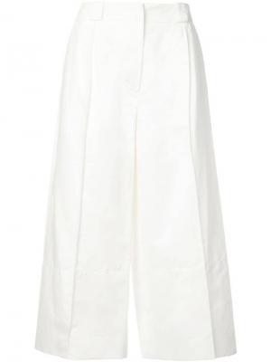 Укороченные расклешенные брюки Marni. Цвет: белый