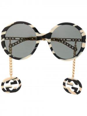 Солнцезащитные очки в круглой оправе с логотипом Interlocking G Gucci Eyewear. Цвет: нейтральные цвета