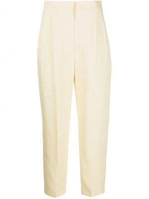 Зауженные брюки строгого кроя Alexander McQueen. Цвет: желтый