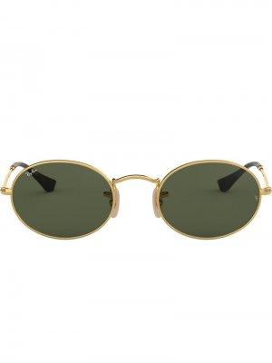Овальные солнцезащитные очки Ray-Ban. Цвет: золотистый