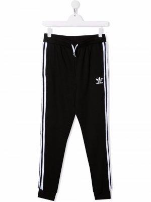 Спортивные брюки с логотипом adidas Kids. Цвет: черный