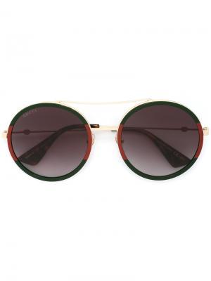 Солнцезащитные очки с круглой оправой Gucci Eyewear. Цвет: зеленый