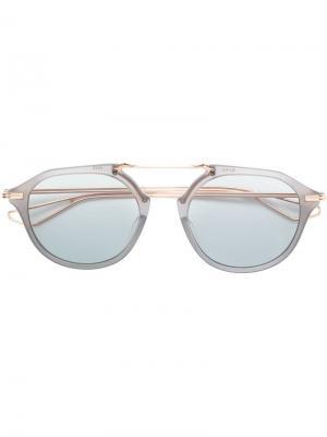 Затемненные солнцезащитные очки в круглой оправе Dita Eyewear. Цвет: золотистый