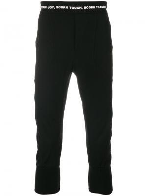 Укороченные спортивные брюки с надписью на талии NILøS. Цвет: черный