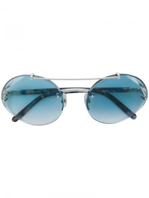 Солнцезащитные очки в круглой оправе Swarovski Eyewear. Цвет: синий