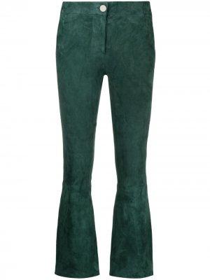 Расклешенные брюки Arma. Цвет: зеленый