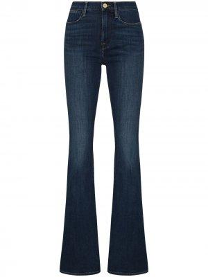 Расклешенные джинсы средней посадки FRAME. Цвет: синий