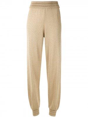 Трикотажные брюки Eva. Цвет: золотистый